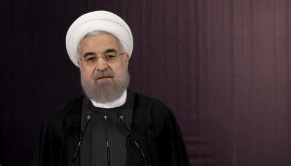 Iranian President Hassan Rouhani talks to journalists after he registered for February's election of the Assembly of Experts, the clerical body that chooses the supreme leader, at Interior Ministry in Tehran
