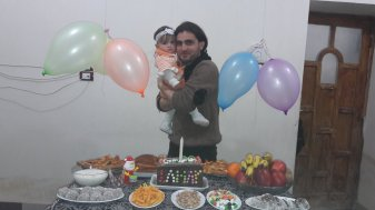 Abdulkafi Al Hamdo with his daughter Lamar in her first birthday
